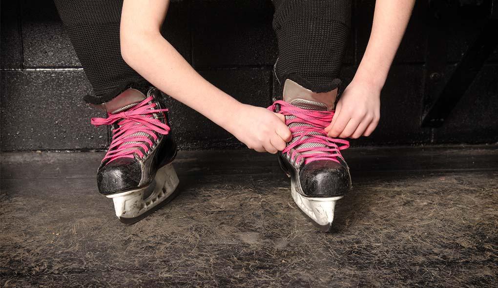 Lacing up hockey skates