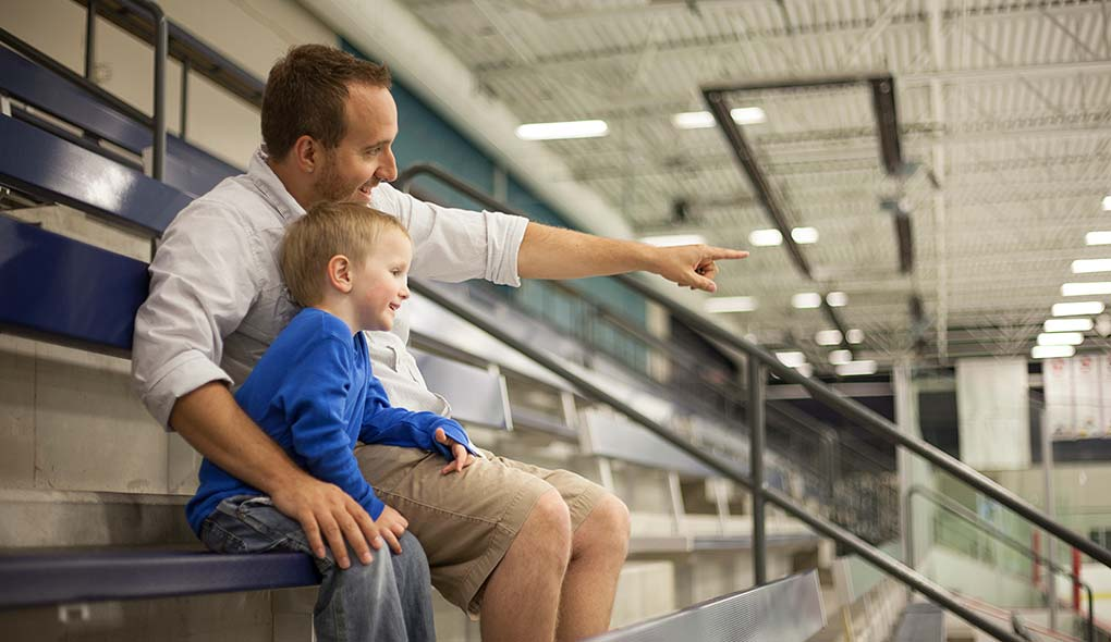 Hockey dad and kid