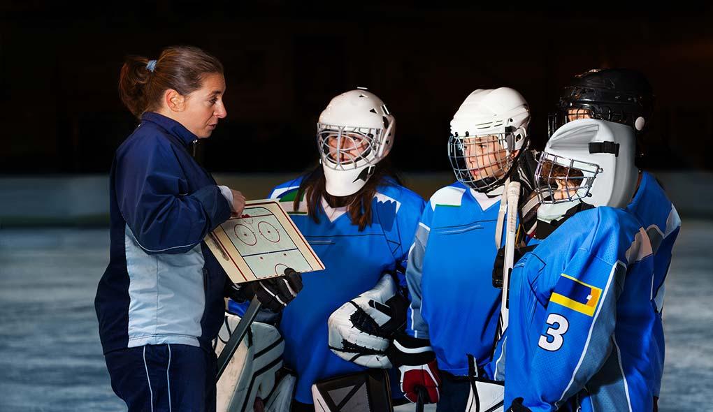 hockey coach and team